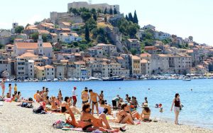 People basking in the sun at Banj beach in Sibenik