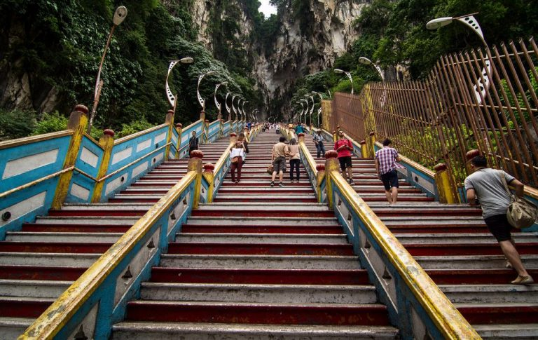 Climb the stairs to the cave