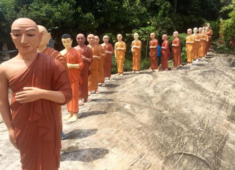 Buddha statues of different ages and monks
