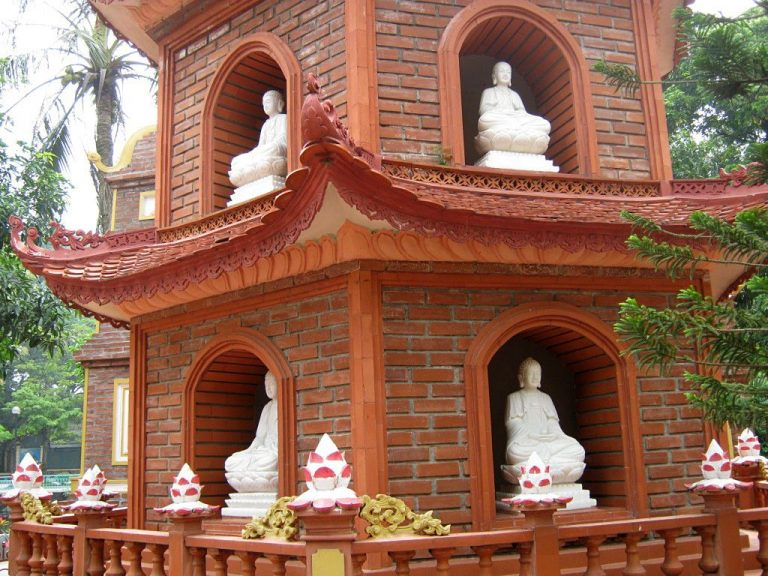 Buddha statues on each tier of Chiang Quoc Pagoda