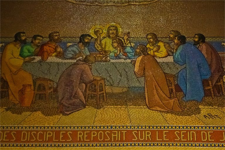 There are many biblical mosaics on the walls.