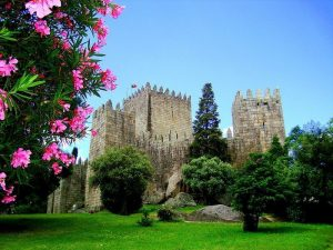 Guimarães Castle with green lawn outside