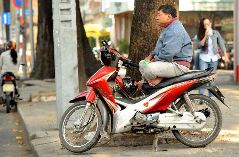 Photo: taxi driver on a bike
