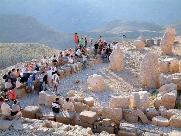 Tourists on the mountain Nemrut Dag