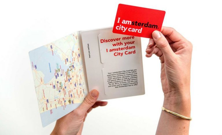 The map includes a guide to Amsterdam, a city map and a glossy travel magazine