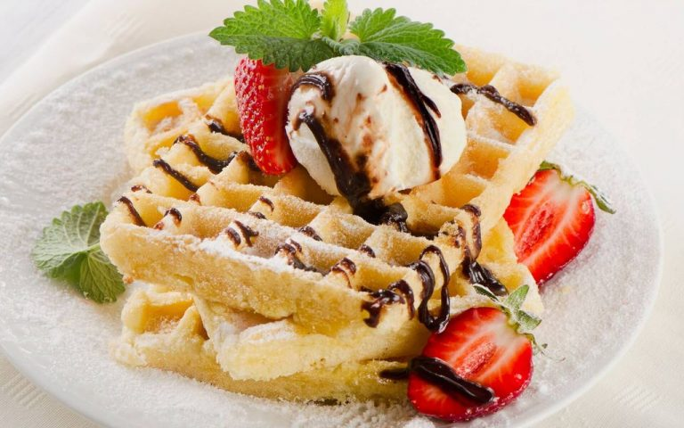 Belgian waffles with ice cream and strawberries