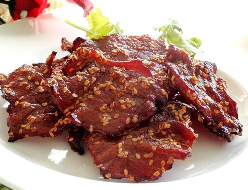 Sliced ​​ostrich meat in sesame seeds