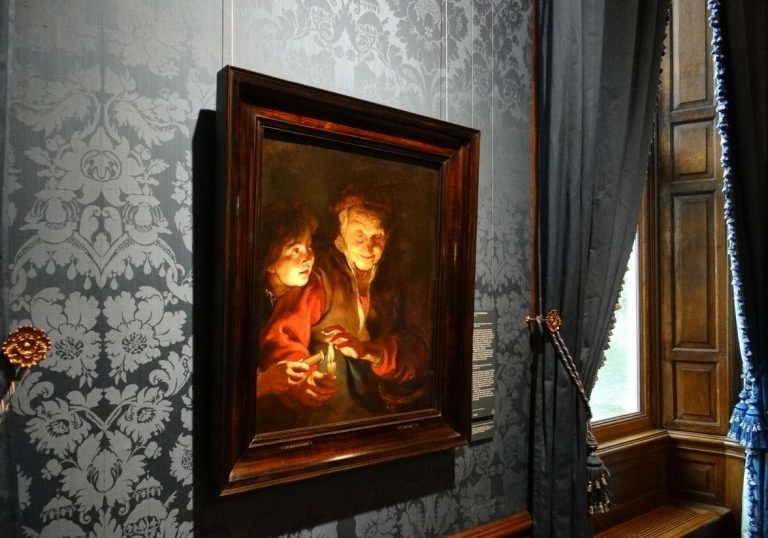 Painting by Peter Paul Rubens - an old woman and a boy with candles
