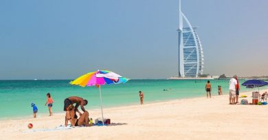 Family under a sun umbrella on a beach in Dubai