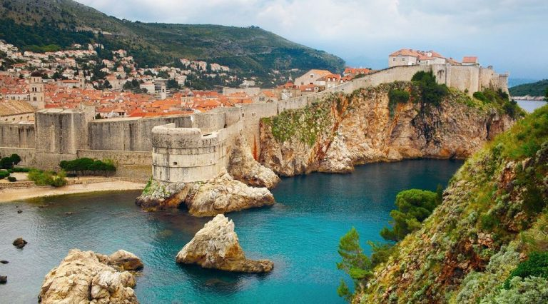 The streets of Dubrovnik are surrounded by a powerful giant wall.
