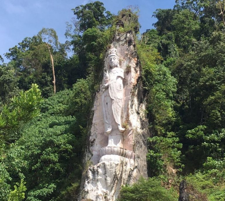 The statue of the goddess carved in the rock