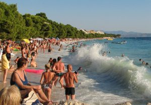 People and sea waves at Tučepi beach on the Adriatic Croatia