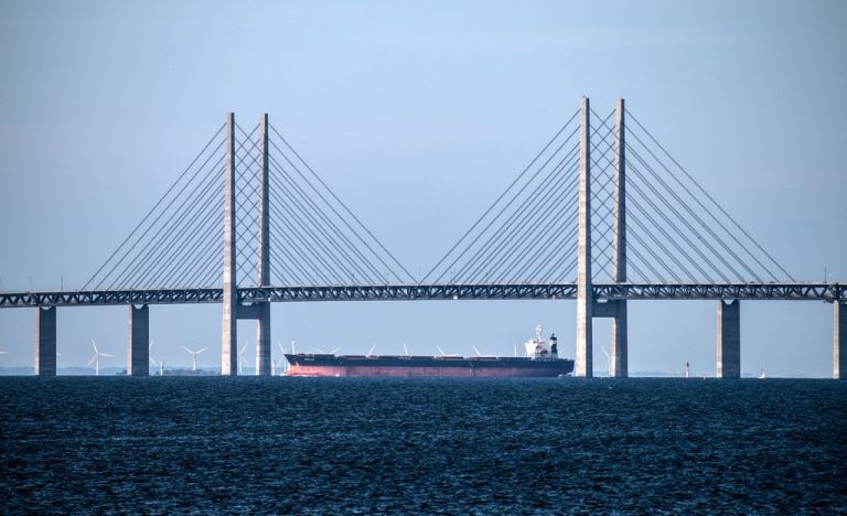 Tanker Sailing Under Oresund Bridge
