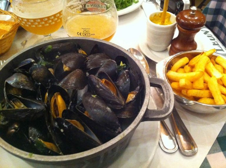 French fries and spicy mussels with a mug of beer