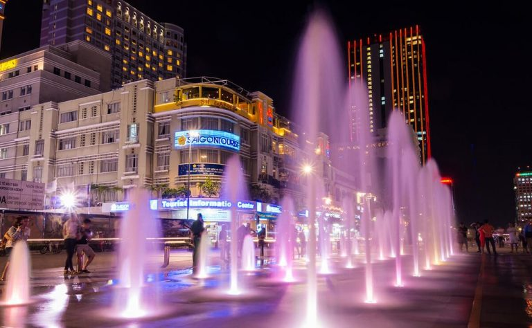 Fountains in the evening at Ho Chi Minh City Square