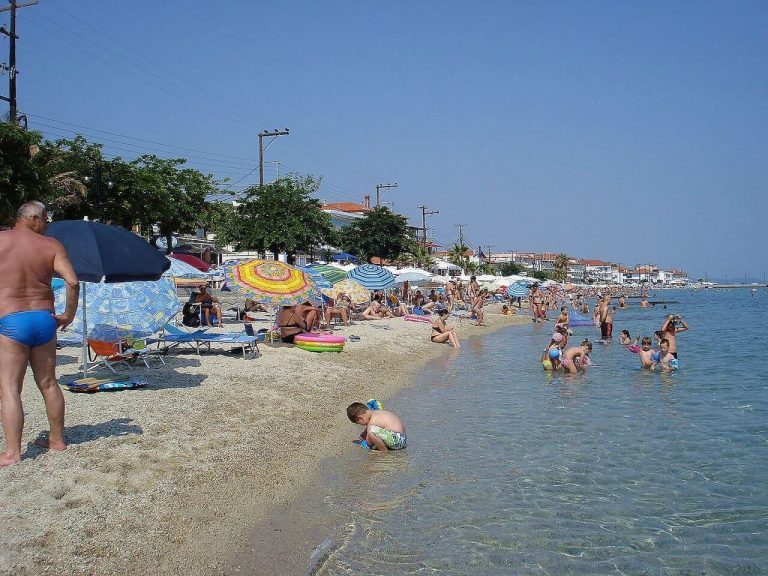 Holidaymakers on the beach in Pefkohori